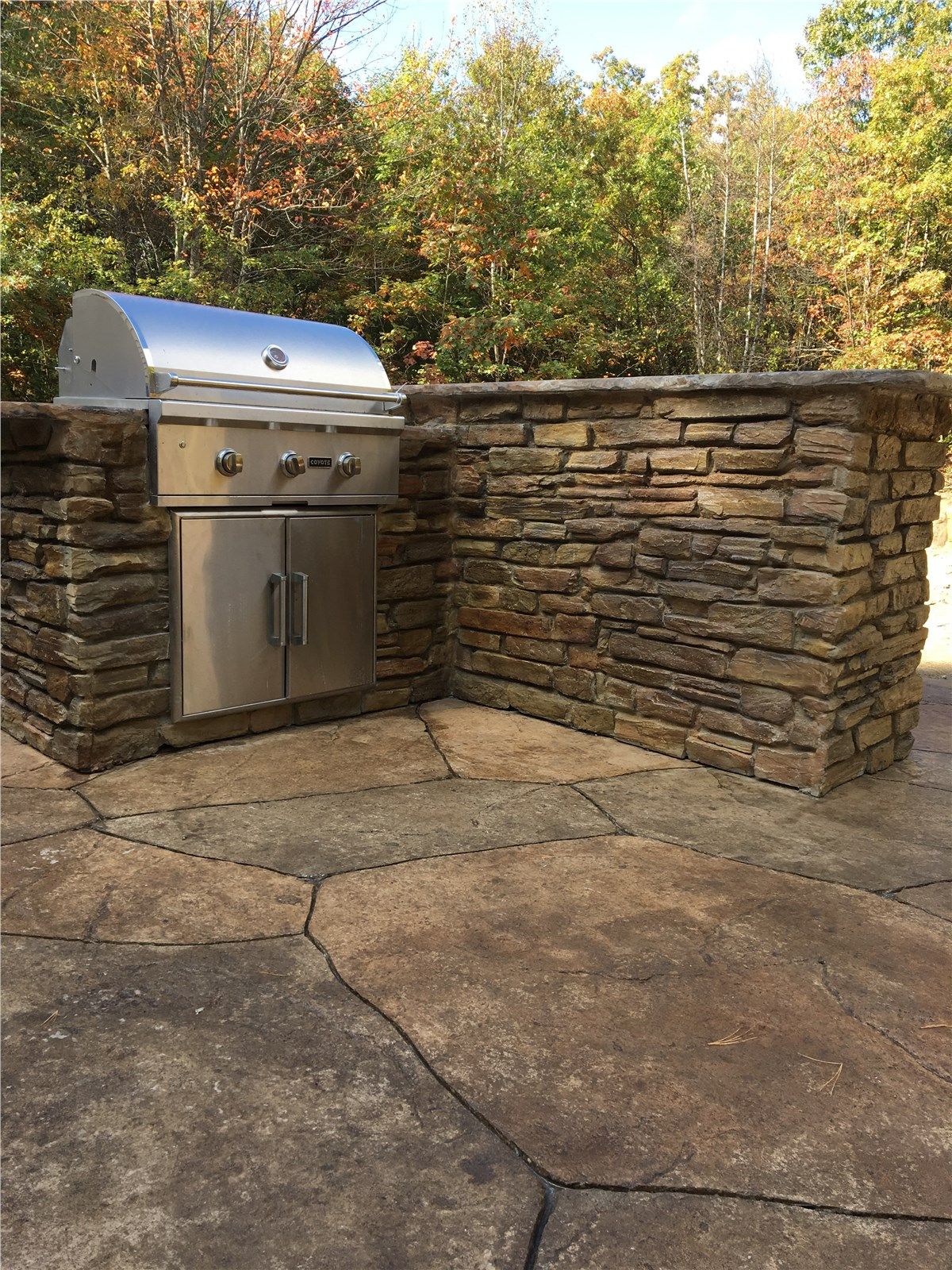 outdoor kitchen on paved patio