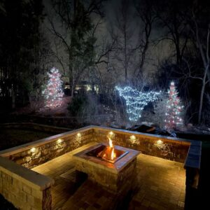 picture of backyard fire pit and seating wall